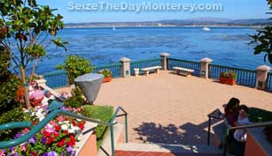 The Monterey Bay Inn is at the beginning of Cannery Row, about .6 miles from the Monterey Bay Aquarium.  A very nice and scenic walk indeed!