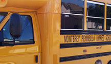 School Buses Parked near the Monterey Aquarium Means loads of kids on a field trip