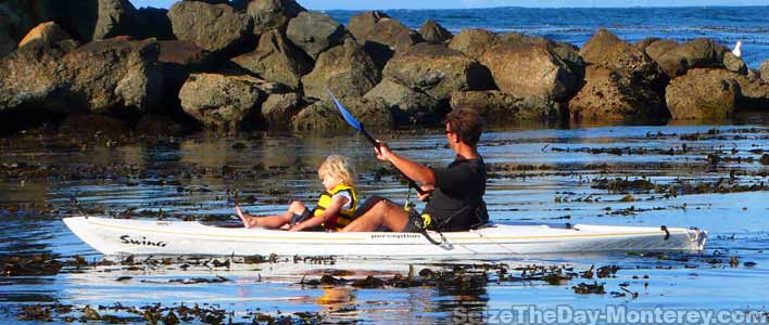 Kayaking with the kids off of the calm waters at Lover's Point Beach is great fun here in Monterey California!