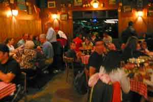 A Table at Gianni's can be hard to find during peak hours.  Ask a staff member if you can sit in the back dining area.